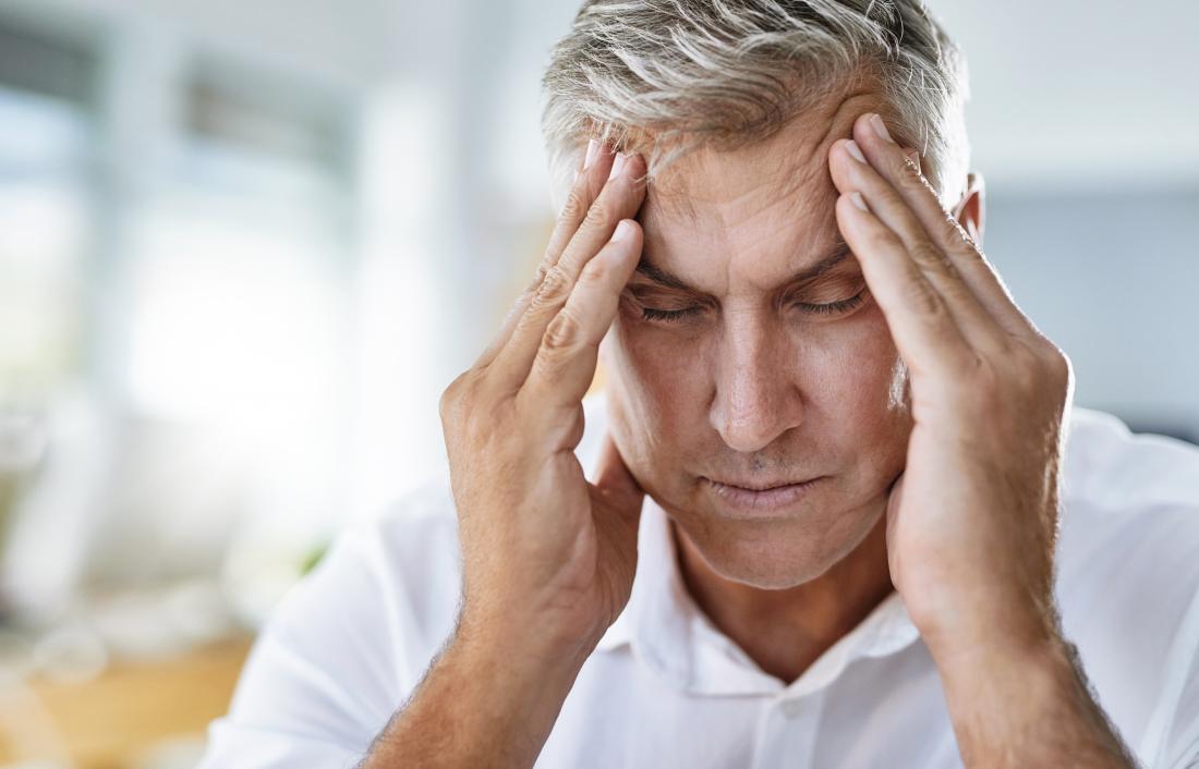 man with hypertension headache