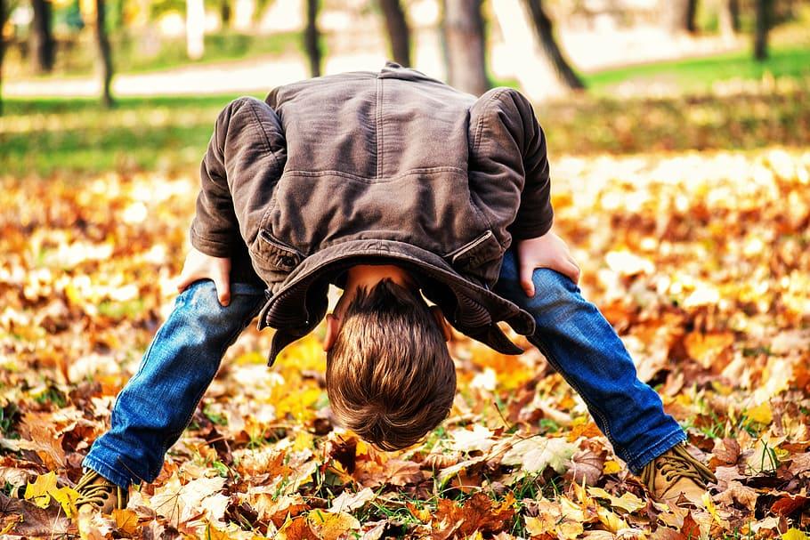 toddler child looking through legs toddlers playing